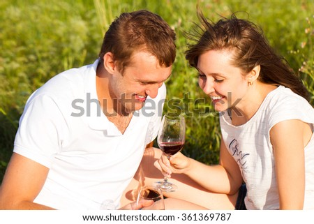 Portrait of a happy couple in love relaxing on a picnic in the countryside