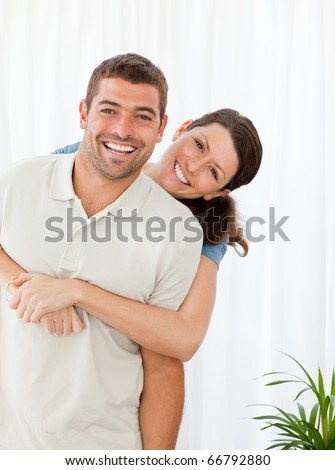 Portrait of a happy couple standing in the living room at home