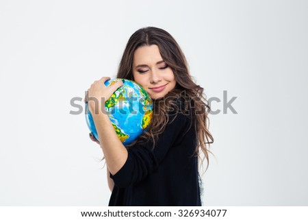 Portrait of a happy cute woman hugging globe isolated on a white background