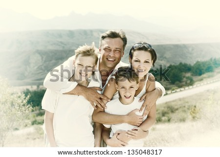portrait of a happy family in the morning in the open air