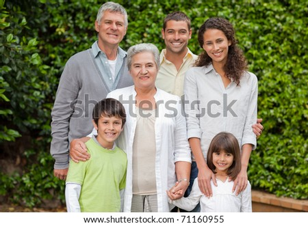 Portrait of a happy family looking at the camera in the garden