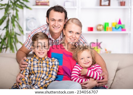 Portrait of a happy family. Young parents and their two children.