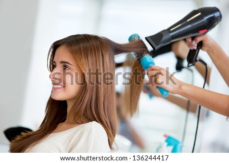 Portrait of a happy woman at the hair salon