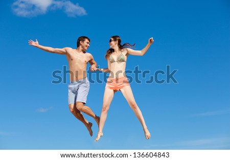 Portrait of a happy young couple enjoying at beach