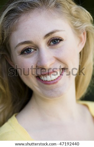 Portrait of A Happy Young Woman Smiling To Camera