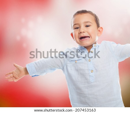 portrait of a little boy opening his arms like a hug