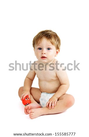 portrait of a little boy with a toy in his hand photo on the white background.