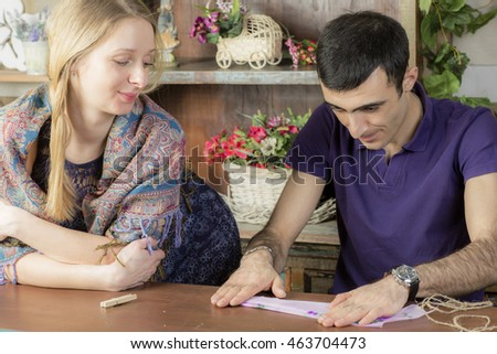 Portrait of a man and a pregnant woman. Young couple in a country house on vacation.