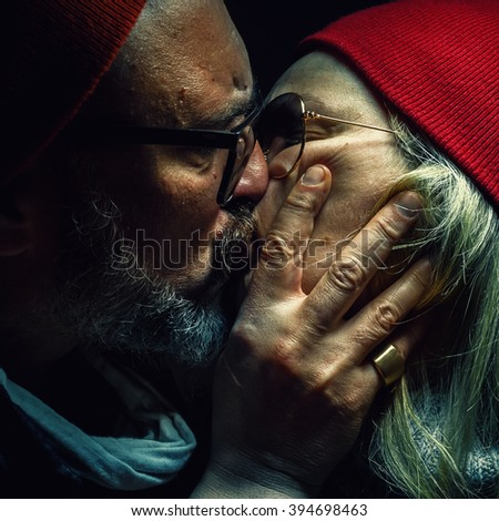 Portrait of a man and woman, deeply loved and hugged.