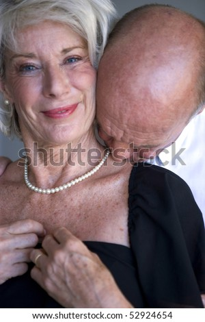 Portrait of a man kissing his wife's neck