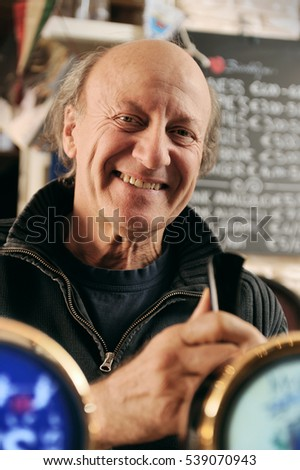 Portrait of a man working in a pub