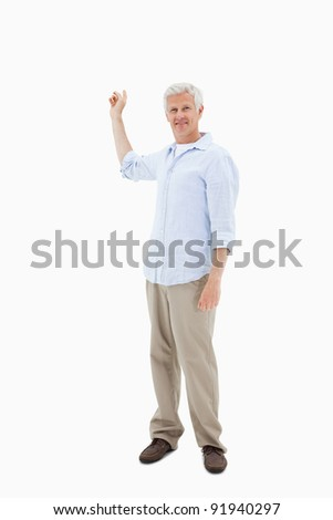 Portrait of a mature man pointing at something against a white background