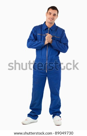 Portrait of a mechanic against a white background