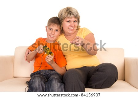 portrait of a nice boy playing with mom