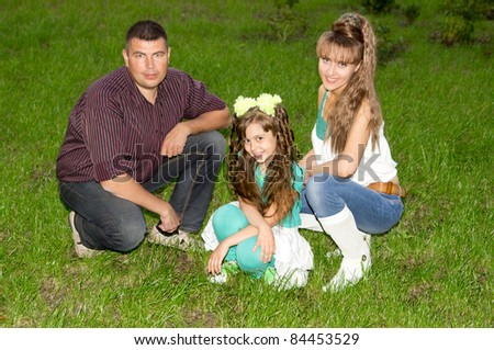 portrait of a nice family of a three  outdoors
