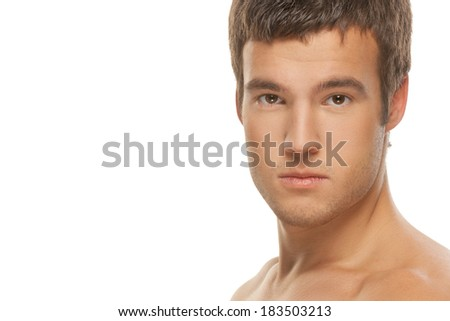 Portrait of a pensive male athlete muscular isolated on a white background