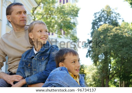 portrait of a pretty dad with little boys