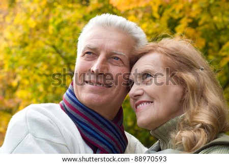 portrait of a pretty elderly couple posing at nature