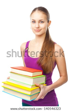 Portrait of a pretty smiling student girl holding stack of books isolated on white background