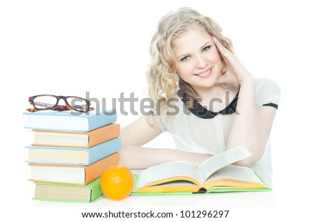 Portrait of a pretty smiling teenage girl with a stack of books on white