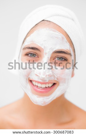 Portrait of a pretty woman having white cream on her face