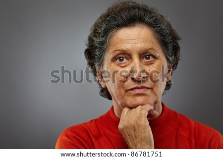 Portrait of a sad senior woman deep in thoughts