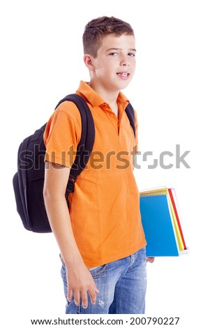 Portrait of a school boy with backpack holding notebooks, isolated on white background