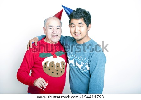 Portrait of a Senior adult man and a young Asian man wearing Christmas