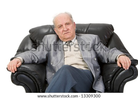 Portrait of a senior man sitting in an armchair.