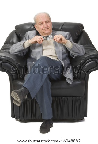 Portrait of a senior man sitting in an armchair and thinking deeply.