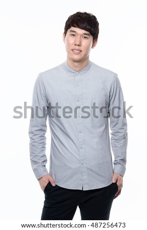 portrait of a smart young asian businessman white background
