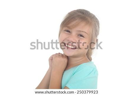 portrait of a smiling little girl on a white background