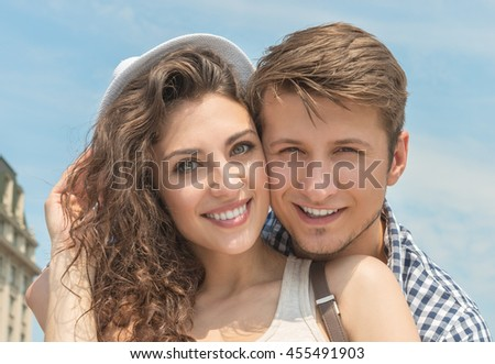 Portrait of a smiling young couple enjoying the day together
