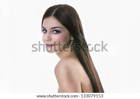 Portrait of a smiling young woman with beautiful hair