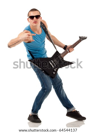 Portrait of a successful rock star holding an electric guitar and making a rock sign