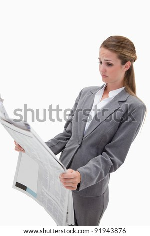 Portrait of a surprised businesswoman reading the news against a white background