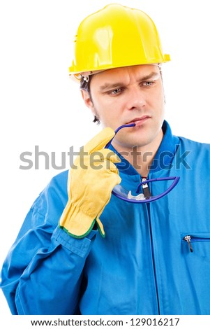 Portrait of a thoughtful construction worker with helmet isolated on white background