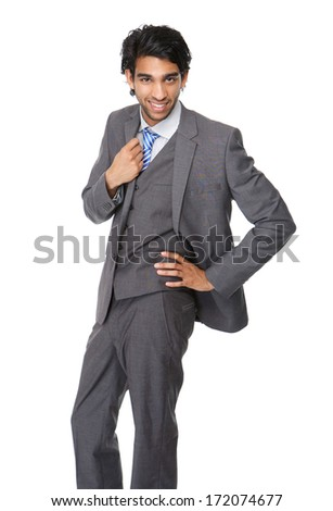 Portrait of a trendy young businessman standing on isolated white background