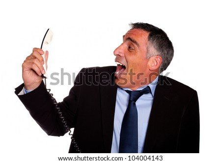 Portrait of a very stressed latin business man laughing with a phone against white background