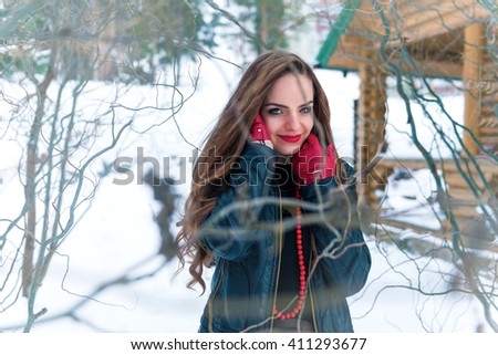 portrait of a woman in a winter coat in the forest