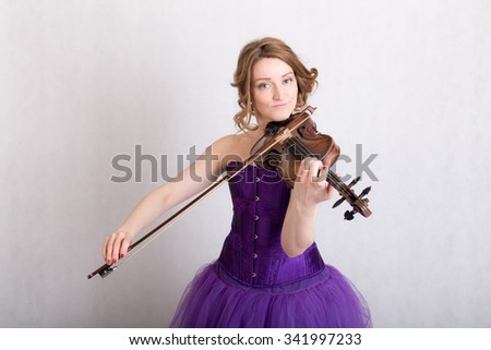 Portrait of a woman playing the violin