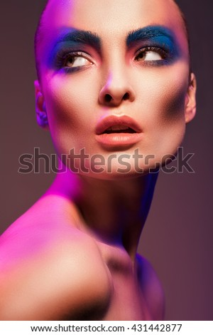 Portrait Beauty Girl Purple Dust Makeup Stock #0: stock photo portrait of a woman with neon lights and bright makeup