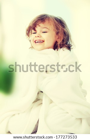 Portrait of a 5 year old girl after bath, isolated on white background