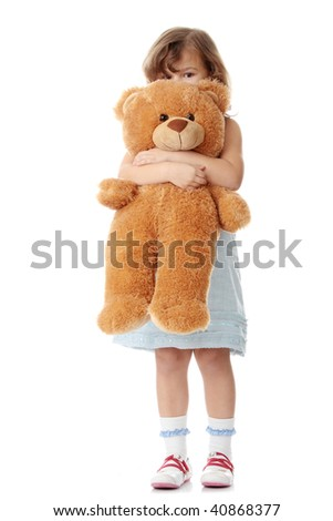Portrait of a 5 year old girl with teddy bear isolated on white background