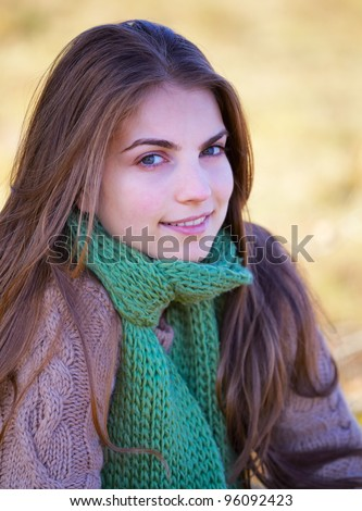 Portrait of a 20 year old woman outdoor in autumn.