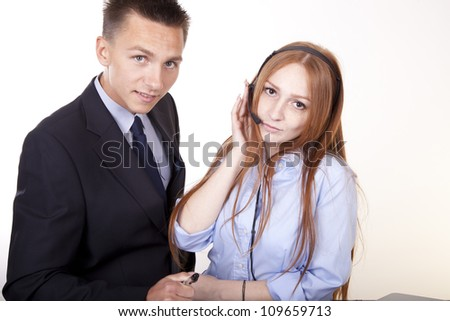 Portrait of a young attractive business couple working.
