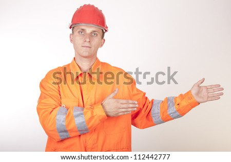 Portrait of a young attractive male construction working.