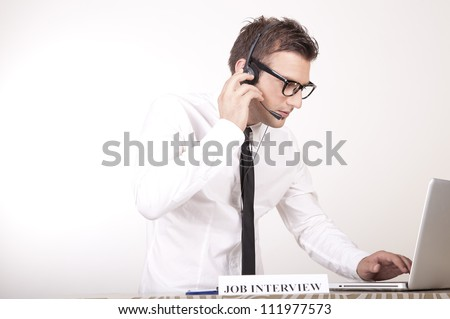 Portrait of a young attractive male receptionist with a sign job interview.