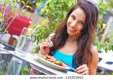 stock photo portrait of a young attractive woman eating salad at cafe table horizontal shot beautiful young 133203863