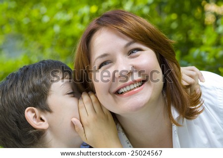 Portrait of a young boy with his mother in summer environment